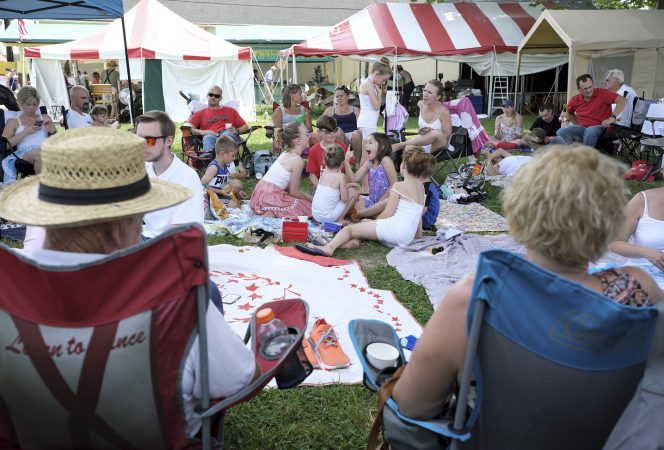 Members of the Miller Family rest between performances of the Miller Family Hoedown on July 1, 2018, during the Kutztown Folk Festival in Kutztown, Pennsylvania. (Matt Smith for WHYY)