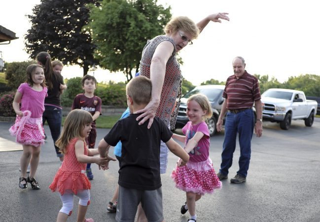 Linda Rutherford (center) helps direct her grandchildren as members of the Miller Family practice their hoedown routine June 7, 2018, at the home of Lester Miller in Kutztown, Pennsylvania. (Matt Smith for WHYY)