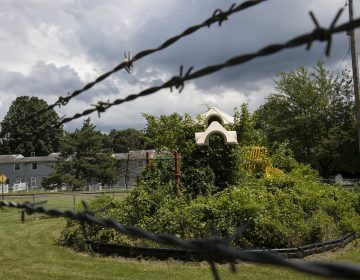 In this Aug. 1, 2018 photo weeds engulf a playground at housing section of the former Naval Air Warfare Center Warminster in Warminster, Pa. the foams once used routinely in firefighting training at military bases contained PFAS. (AP Photo/Matt Rourke)
