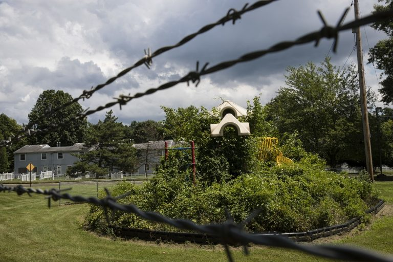 In this Aug. 1, 2018 photo weeds engulf a playground at housing section of the former Naval Air Warfare Center Warminster in Warminster, Pa. the foams once used routinely in firefighting training at military bases contained PFAS. (Matt Rourke/AP Photo)