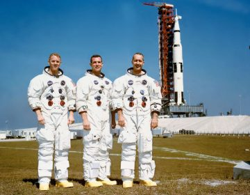 These three astronauts are the prime crew of the Apollo 9 Earth-orbital space mission. Left to right, are Russell L. Schweickart, lunar module pilot; David R. Scott, command module pilot; and James A. McDivitt, commander. In the right background is the Apollo 9 space vehicle on Pad A, Launch Complex 39, Kennedy Space Center (KSC). They are pausing momentarily during training for their scheduled 10-day mission. (NASA)