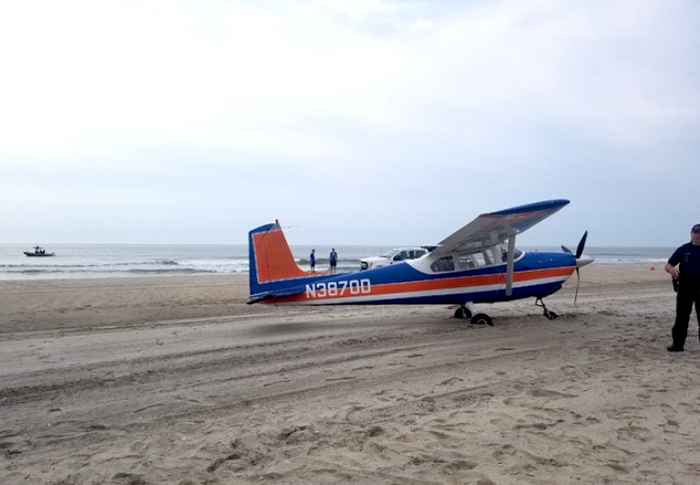 A plane on an Ocean City beach after an emergency landing Saturday morning. (Image courtesy of the Ocean City Police Department)
