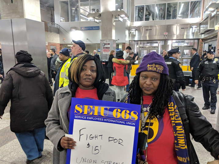 Home healthcare workers Stephanie Williams, (left), and Lolita Owens rally at the Frankford Transportation Center in February to pressure state lawmakers to increase the state minimum wage to $15 an hour. (Michael D'Onofrio/The Philadelphia Tribune)