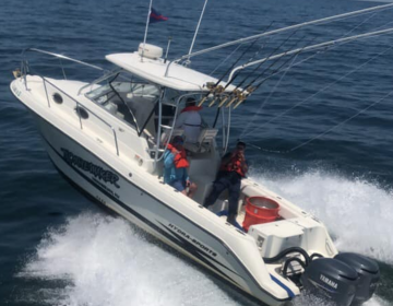 A Coast Guard member aboard the vessel