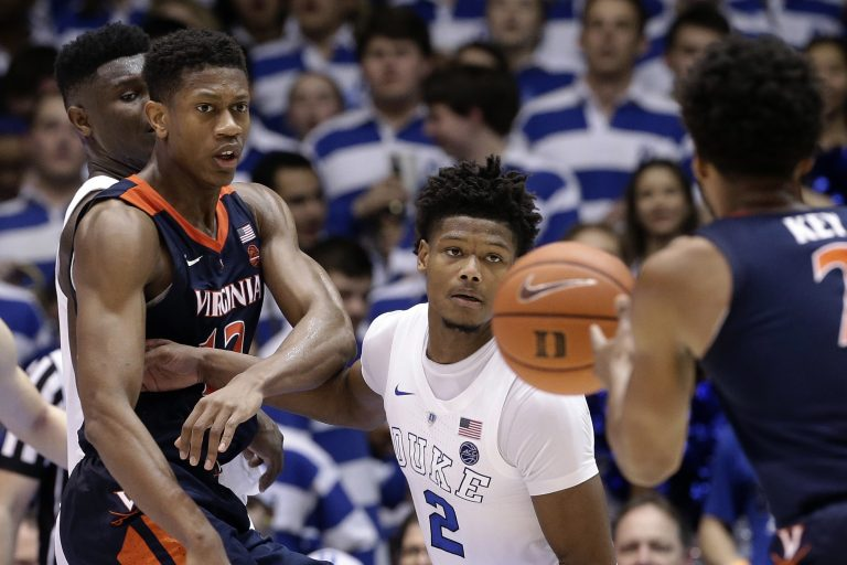 Duke's Cam Reddish (2) keeps an eye on the ball against Virginia's De'Andre Hunter, (left), and Braxton Key (2) during the second half of an NCAA college basketball game in Durham, N.C., Saturday, Jan. 19, 2019. Duke won 72-70. (Gerry Broome/AP Photo)
