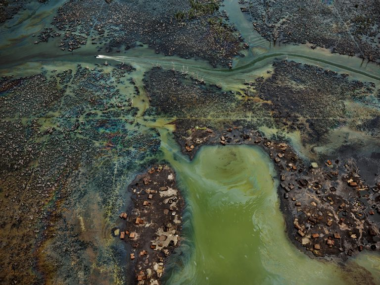 In Nigeria's oil-rich Niger Delta, oil bunkering — the practice of siphoning oil from pipelines — has transformed parts of the once-thriving delta ecosystem into an ecological dead zone, according to the U.N. Environment Programme. (Edward Burtynsky, courtesy Robert Koch Gallery, San Francisco / Nicholas Metivier Gallery, Toronto)