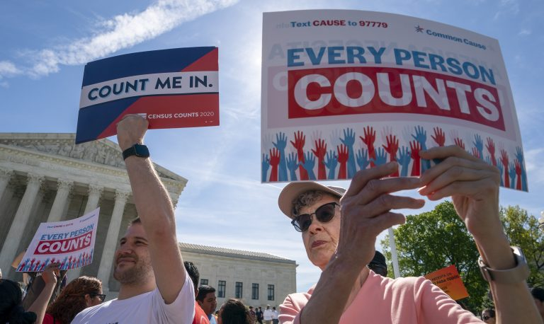 Demonstrators rally outside the Supreme Court in April as the justices hear arguments over the Trump administration's plan to add a citizenship question to 2020 census forms. (J. Scott Applewhite/AP)