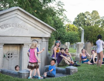 Kids and aerialists play side by side in the Woodlands cemetery. (Emily Cohen for WHYY)