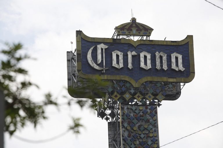 A Corona beer billboard is displayed at the Grupo Modelo beer factory, maker of Corona beer, in Mexico City, Mexico, Friday, May 31, 2019. If the tariffs threatened by United States President Donald Trump on Thursday were to take effect, they could eventually raise prices in the US, for a new Chevrolet Blazer SUV, a burrito at Chipotle, a new shirt or a Corona beer. (AP Photo/Ginnette Riquelme)