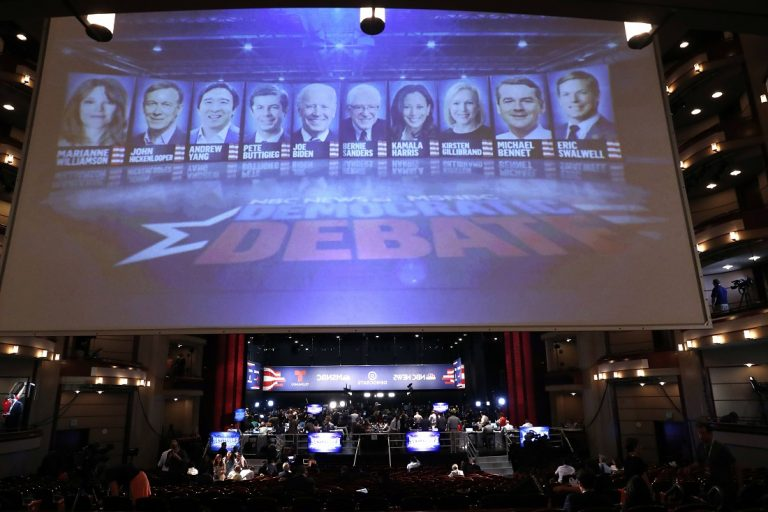 A monitor displays the Democratic presidential candidates that will appear during the second night of the Democratic primary debate hosted by NBC News at the Adrienne Arsht Center for the Performing Arts, Wednesday, June 26, 2019, in Miami. (AP Photo/Brynn Anderson)