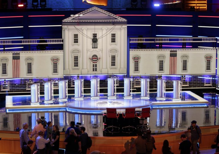 Members of the media gather for a walk-through of the stage set-up for the first democratic debate, Wednesday, June 26, 2019. Ten presidential candidates, led by Sen. Elizabeth Warren, are set to converge on the debate stage on the first night of Democratic debates to offer their pitches to the American people and attempt a breakout moment for their campaigns. (Marta Lavandier/AP Photo)