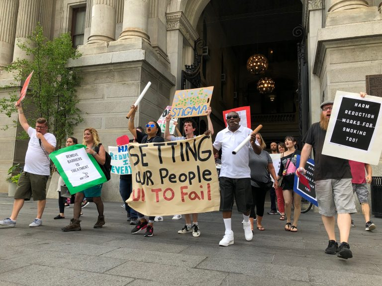 Protesters gathered at city hall opposing the city's smoking ban in inpatient addiction treatment facilities (Nina Feldman/WHYY)