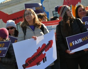 People gather during a rally to coincide with the Supreme Court hearings on the redistricting cases in Maryland and North Carolina in front of the Supreme Court on March 26. (Mandel Ngan/AFP/Getty Images)