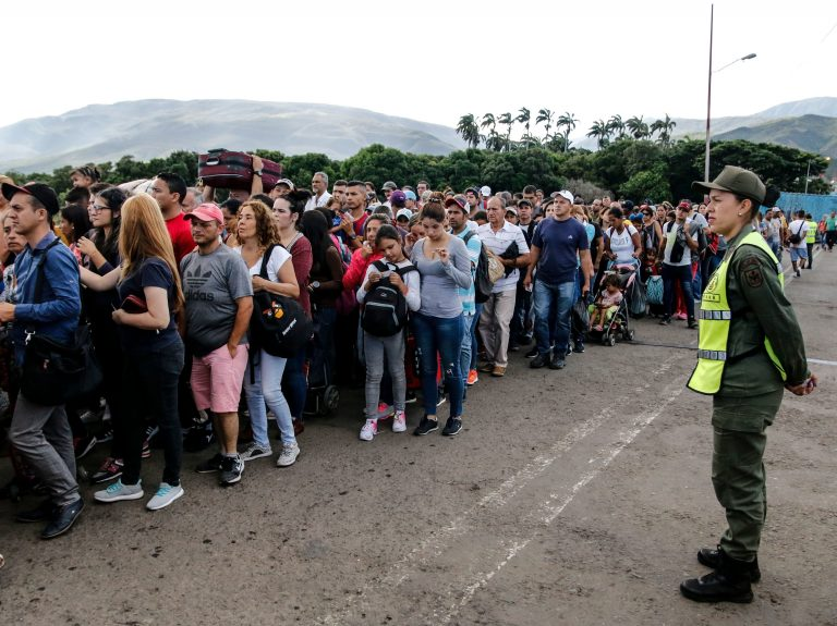 People line up to cross the Simon Bolivar international bridge from San Antonio del Tachira in Venezuela to Cucuta, in Colombia, to buy goods due to supplies shortage in their country. Venezuela's President Nicolás Maduro ordered the reopening of the country's border with Colombia on Friday. (SCHNEYDER MENDOZA/AFP/Getty Images)