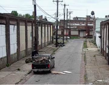 Illegal dumpers throw construction debris on a Philadelphia street in a video screen capture from a video released by the City of Philadelphia.
