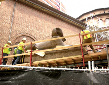 "The Penn Museum used ""glorified hoverboards"" to lift its 13-ton ancient Egyptian sphinx to its new home at the entrance, where it will greet visitors. (Kimberly Paynter/WHYY)"