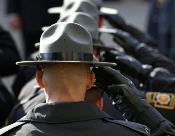 State Police salute in Johnstown. (Gene J. Puskar/AP Photo)
