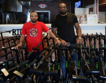 CEO Kevin Thompson and COO Naim Statham present their fleet of close to a hundred Verve E-scooters, stored at a former hamburger take-out restaurant located at the corner of Roosevelt Blvd and F Street, on June 15, 2019. (Bastiaan Slabbers for WHYY)