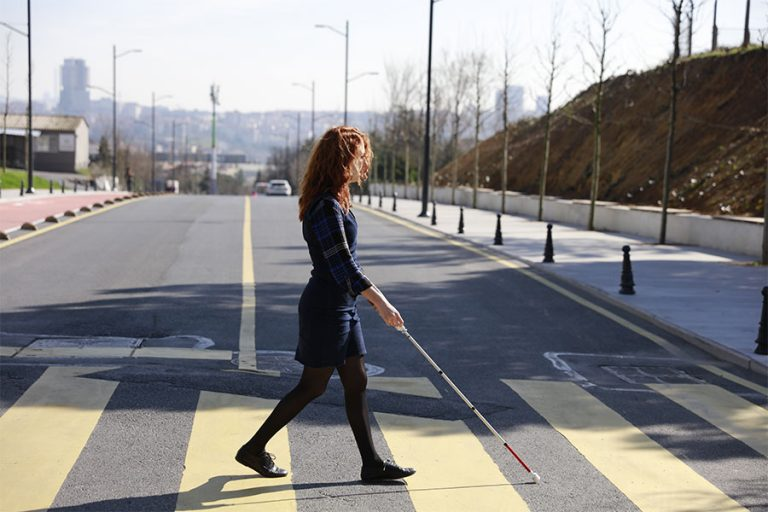 For decades, inventors have tried to re-engineer the standard white cane used by people who are blind or visually impaired. But it's a tricky task. (Image courtesy of WeWALK/Kürşat Ceylan)