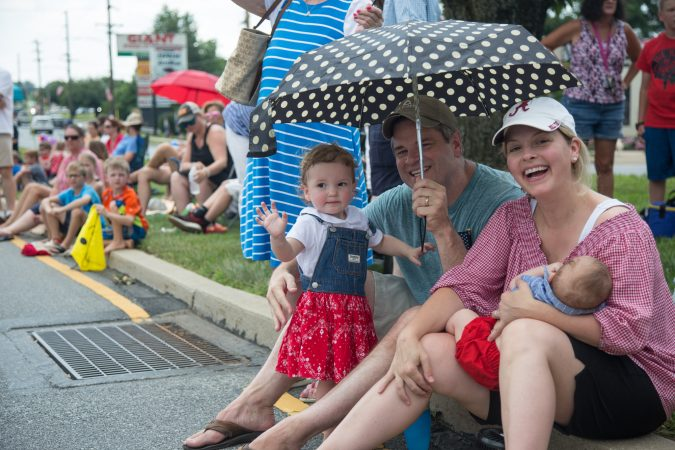 The O'Brien family from Media decided to come to the Marple Newtown Fourth of July parade specifically because of the quiet zone. With two young kids in tow, including a newborn, parents Jessica and Matt appreciated the inclusion of a quiet zone. (Emily Cohen for WHYY)