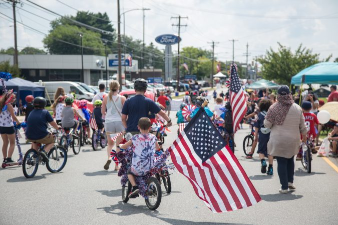 The bike brigade makes their way through the annual Marple Newtown Fourth of July parade. (Emily Cohen for WHYY)