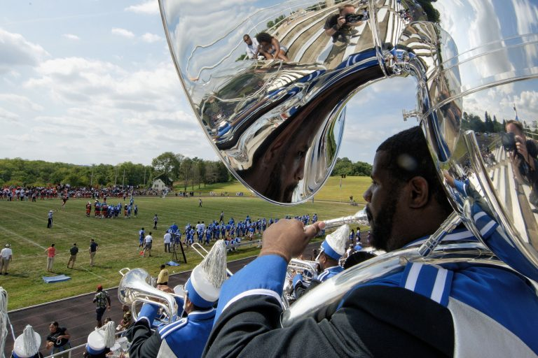 Members of the Cheyney University marching band play in the stands during a football game against Lincoln University. (Bastiaan Slabbers for WHYY)