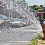 Fire hydrants are open around the city during an historic heatwave in Philadelphia. (Kimberly Paynter/WHYY)