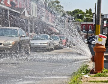 Open fire hydrant during heatwave in Philadelphia