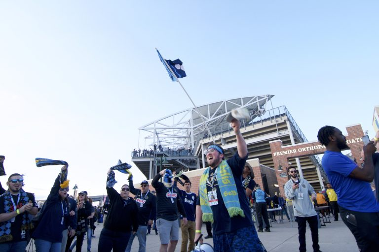 Erick Jusino, of Philadelphia leads a chant on the bullhorn at the Philadelphia Union home game against FC Dallas at Talen Energy Stadium, in Chester, Pennsylvania, on April 6, 2019. (Bastiaan Slabbers for WHYY)