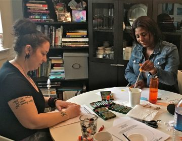 Art therapist Jessica Masino Drass (left) works with Derricia Smith. (Anne Hoffman)