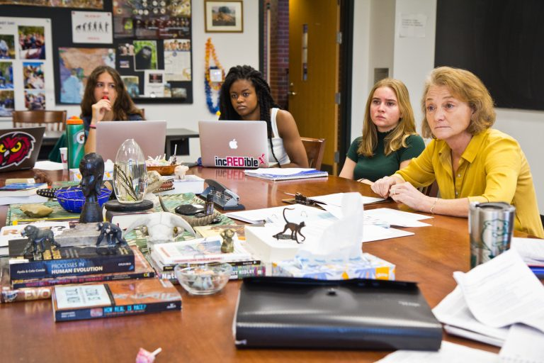 The Lawrenceville School teacher Leah Dombhelps students discuss a lecture on race and biology by Penn professor Sarah Tishkoff. (Kimberly Paynter/WHYY)