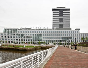 Developments on the Camden waterfront, like the American Water corporate headquarters and the 18-story Camden Tower, receive substantial local tax breaks in addition to state tax incentives. (Emma Lee/WHYY)