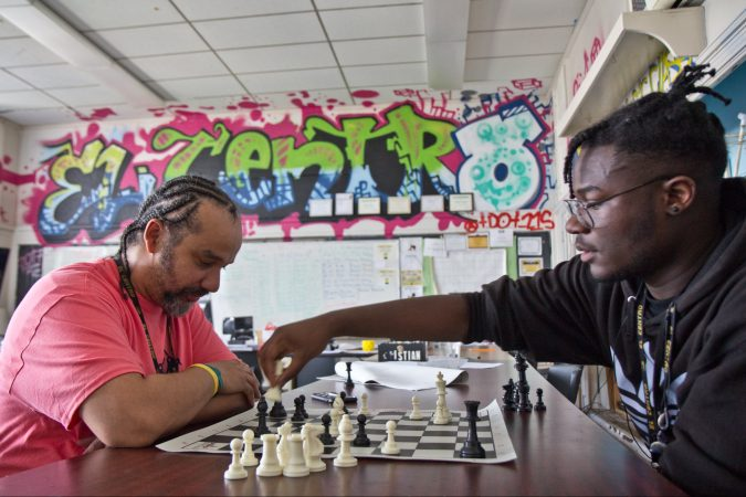 Advisor Doug Cox (left) uses chess at El Centro de Estudiantes as a way to engage students and teach bigger life lessons. (Kimberly Paynter/Keystone Crossroads)