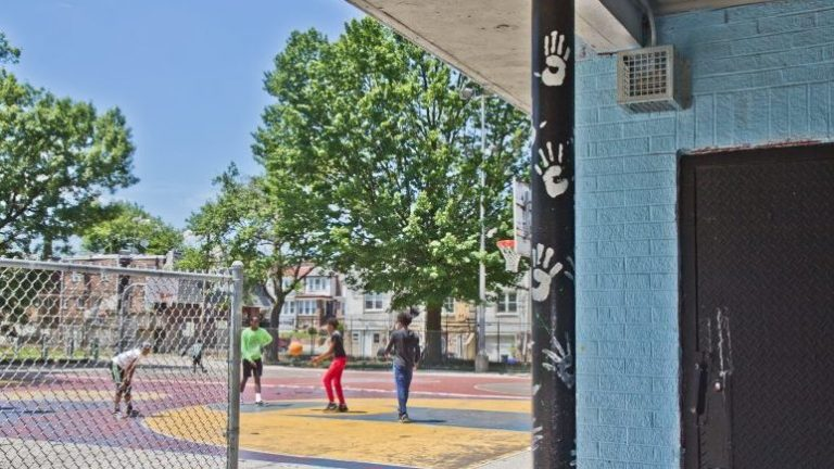 A sonic device is seen (at top right) at Barrett Playground in Philadelphia. Thirty parks in the city have the devices, which emit a constant, high-pitched noise that only teenagers and young adults can hear. (Kimberly Paynter/WHYY)