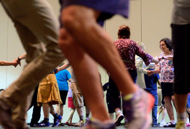 A Center City hotel ballroom is the stage for the 36th LGBT Square Dance Convention. The annual event is organized by the International Association of Gay Square Dance Clubs. (Bastiaan Slabbers for WHYY)