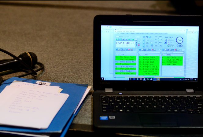 Paper notes lay next to a laptop used by Marilyn 'Zip' Warmerdam to call a 'tip'  at a Center City hotel ballroom during the 36th annual LGBT Square Dance Convention. (Bastiaan Slabbers for WHYY)