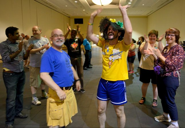 Marilyn 'Zip' Warmerdam receives cheers after calling a fifteen minute tip during the 36th LGBT Square Dance Convention. The annual event is organized by the International Association of Gay Square Dance Clubs. (Bastiaan Slabbers for WHYY)