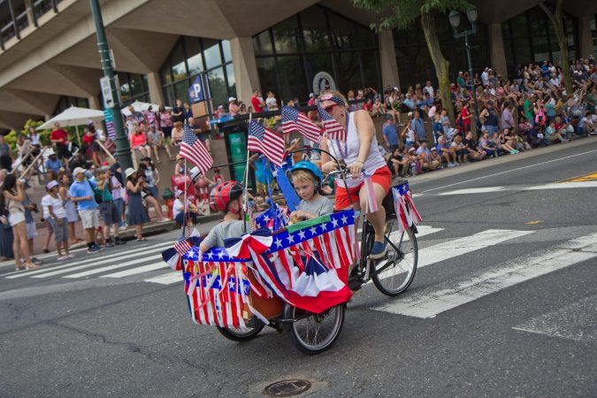 Cyclists celebrate Fourth of July at Philadelphia's Independence Day parade. (Kimberly Paynter/WHYY)