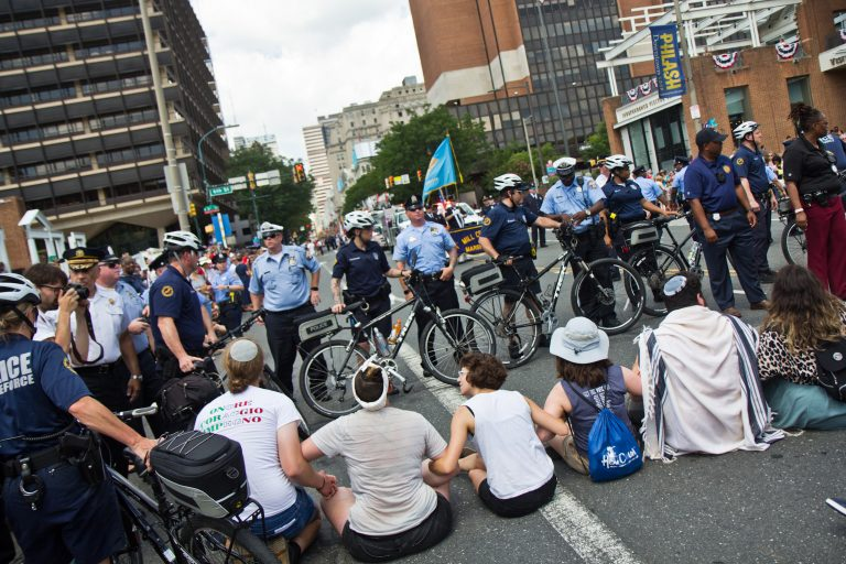 Protesters found a way around the police barricade and blocked Philadelphia's Fourth of July Parade. (Kimberly Paynter/WHYY)