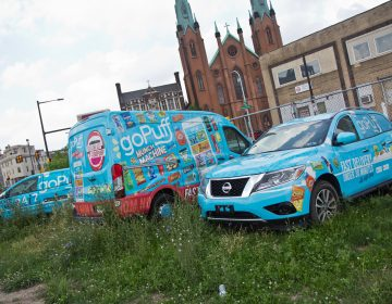 A small fleet of goPuff delivery vehicles, parked outside their Philadelphia headquarters. (Kimberly Paynter/WHYY)