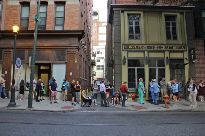 Hundreds wait in a line that began outside the Forrest Theatre on Walnut Street and wrapped around the block onto 11th and Locust streets. for a chance to get tickets to