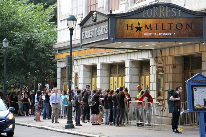 Hundreds line up outside the Forrest Theatre on Walnut Street for a chance to get tickets for