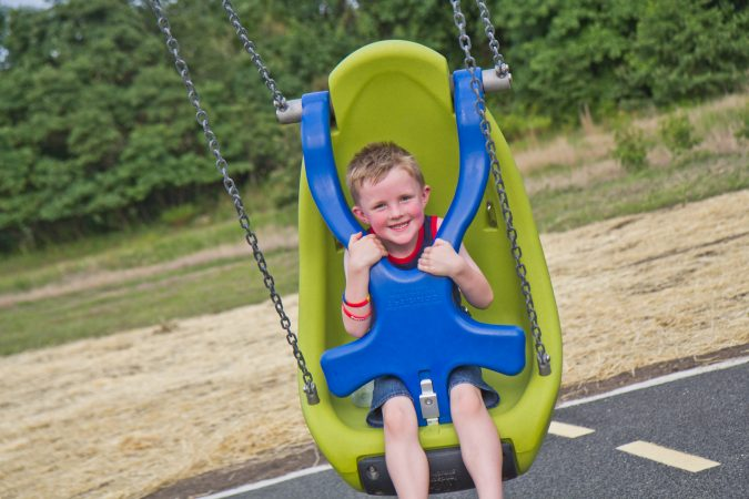 A locking swing allows children of all abilities to swing at BJP. (Kimberly Paynter/WHYY)