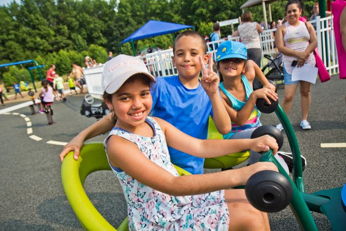 Children play on the four-person sea saw at Delran's Jake's Place. (Kimberly Paynter/WHYY)
