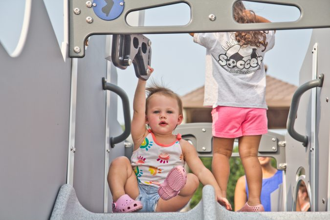 Children play on one of Delran's Jake's Place slides. (Kimberly Paynter/WHYY)