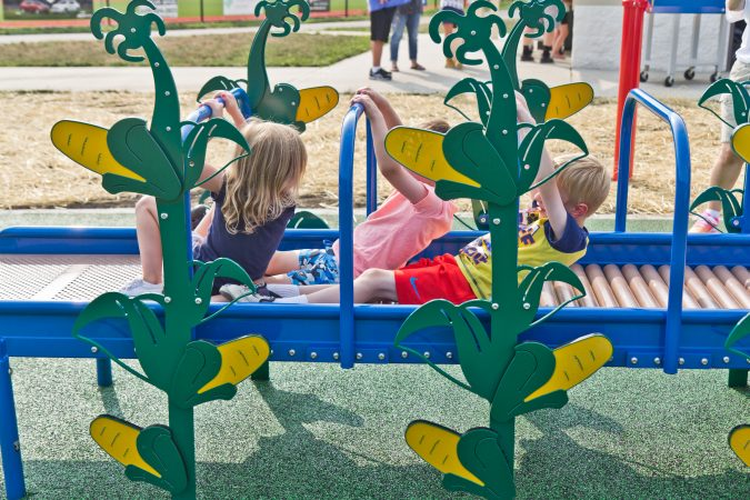 Children glide through the corn roller at Delran's Jake's Place. (Kimberly Paynter/WHYY)