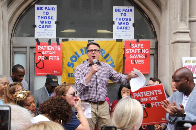 City Council member Bobby Henon speaks at a rally of nurses, doctors, activists and union members seeking to keep Hahnemann Hospital open. (Emma Lee/WHYY)