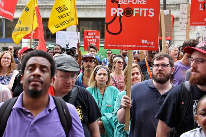 About 800 protesters gather outside Hahnemann Hospital, demanding that the facility remain open and closing the south bound lanes of North Broad Street. (Emma Lee/WHYY)