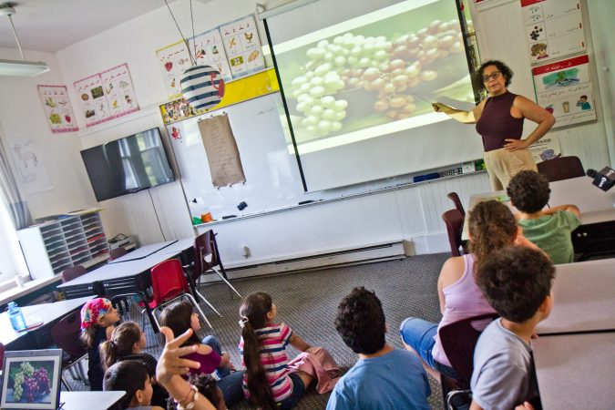 Arabic teacher Farnaz Perry drills food words with Al-Bustan campers. (Kimberly Paynter/WHYY)
