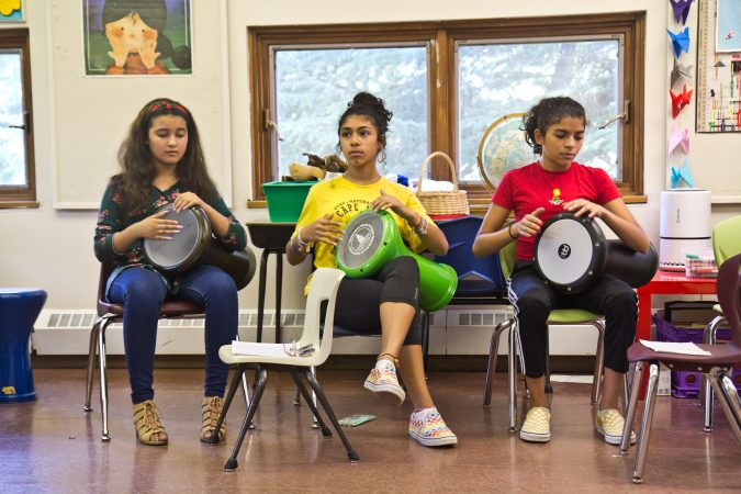 Campers learn Arabic rhythms at the Al-Bustan percussion camp. (Kimberly Paynter/WHYY)